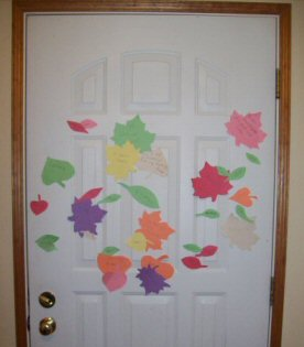 "Door decorated with ""thankful leaves"""